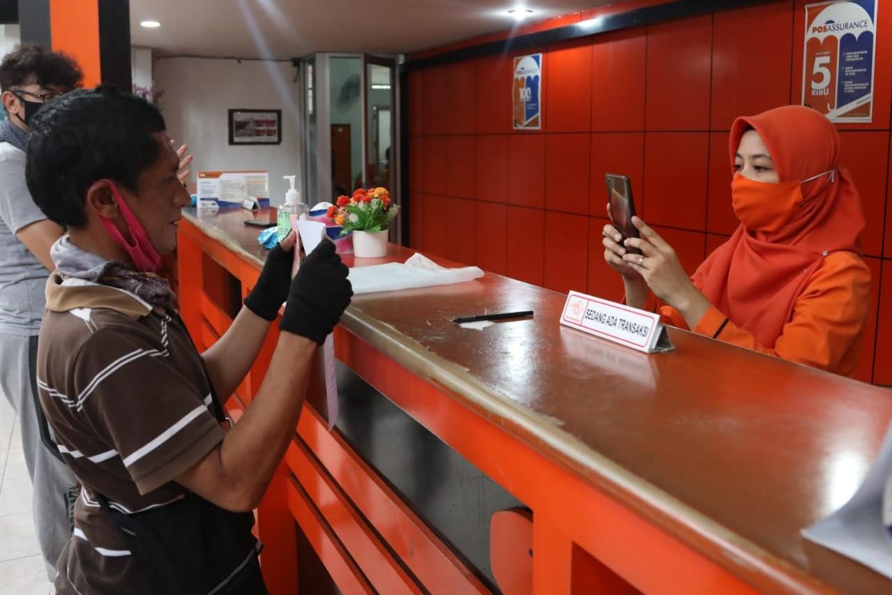 Penyaluran BST Kemensos Gandeng PT Pos Antarkan ke Rumah Penerima